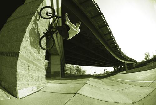 John Mann wallride on an overpass pillar